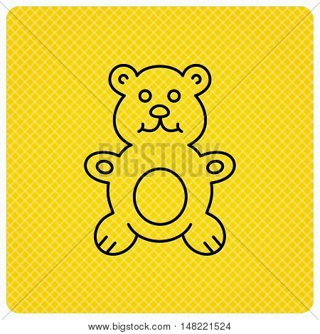 Teddy-bear icon. Baby toy sign. Plush animal symbol. Linear icon on orange background. Vector