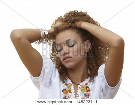 Beautiful woman with her hands in curly hair