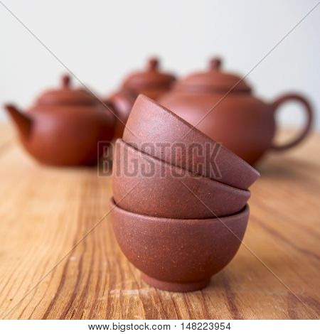 Stackable of chineese cups on vintage wood table