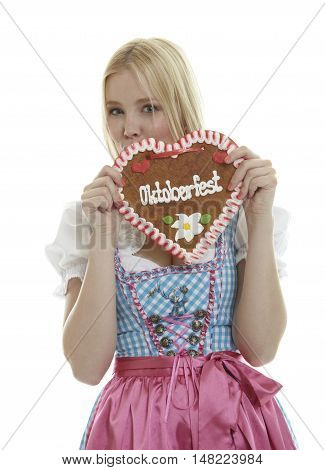Woman with German Oktoberfest Ginger Bread heart