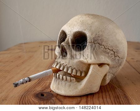 Close up of human skull smoking cigarette