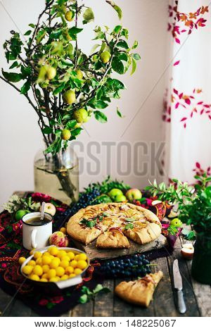 Pie with fruits and marzipan. Pie with fresh pear and apples. a traditional pie filled with jam and fresh fruit, very few ingredients for a classical tart. Homemade apple cake