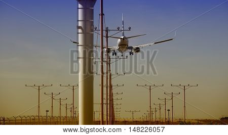 Airplane approaching for Touchdown at sunset with vibrant colors