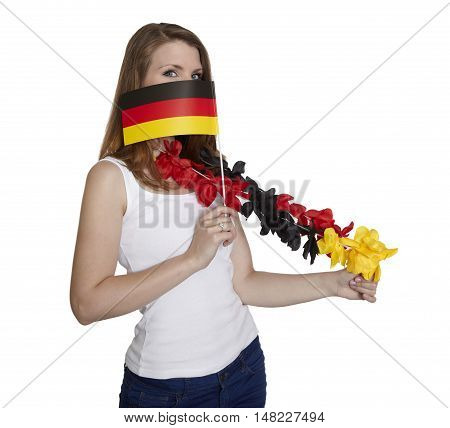 Attractive woman hides her face behind a flag of Germany in front of white background