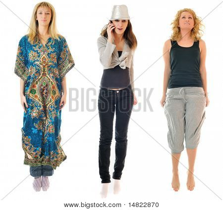 three young happy diverse woman jump in air isolated on white