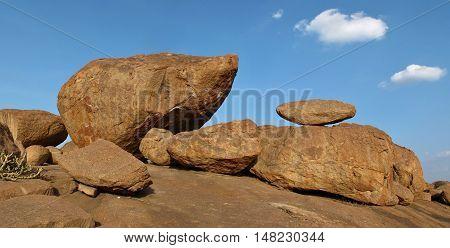 Big boulder popular for bouldering. Smaler balancing boulder on the right. Scene in Hampi India.