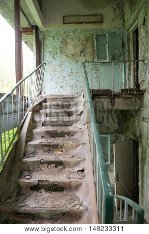 dirty stairs in abandoned building in Pripyat, Chernobyl