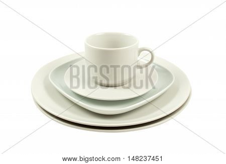 Pile of white plate and white cup isolated on white
