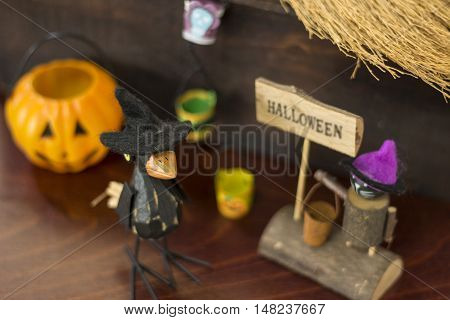 Halloween image with a crow a Jack o lantern and a black cat