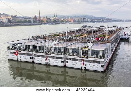 BUDAPEST, SEPTEMBER 17: Pleasure and cruise ships on the Danube River on September 17, 2016 in Budapest, Hungary. Tourist trips along the Danube River in Budapest on water transport are in great demand by travelers from around the world.