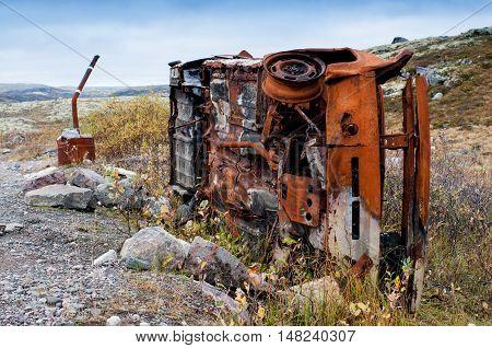 Abandoned rusty car, Kola demi-island, Russia, autumn.
