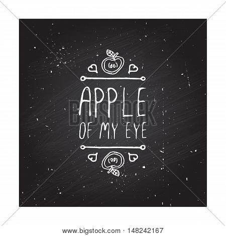 Hand-sketched typographic element with apple, hearts and text on blackboard background. Apple of my eye