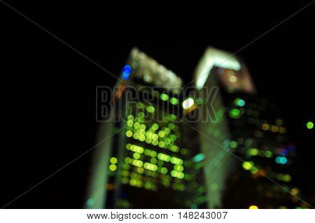 blur light of tall building in the city dark night