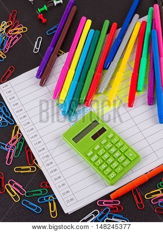 School supplies frame on a chalkboard background