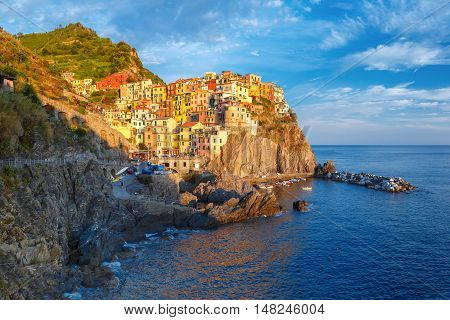 Aerial panoramic view of Manarola fishing village in Five lands, Cinque Terre National Park in the evening, Liguria, Italy.