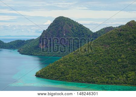 View of islands from top of Bohey Dulang island near Sipadan Island,Sabah.Mirror smooth ocean surrounded by mountains.The bright blue water & rocky shore in the tropical island of Semporna,Borneo