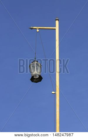Lantern pole on the roof of chinese shrine with blue sky background.