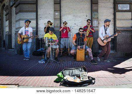 Buenos Aires Argentina - October 4 2013: Street musicians playing in a street in the San Telmo neighborhood in the city of Buenos Aires in Argentina