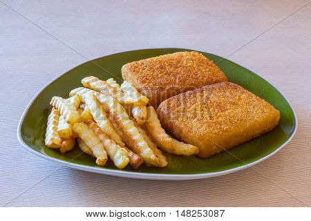 Fish and chips on the table. Dinner dish.