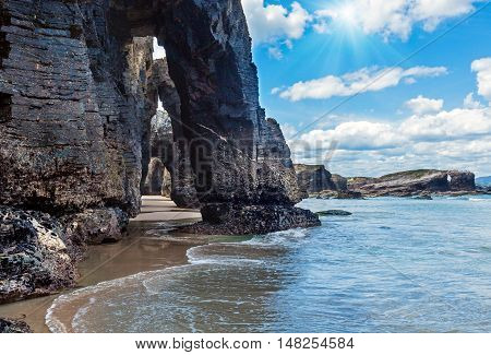 Natural Arches On Beach And Sunshine
