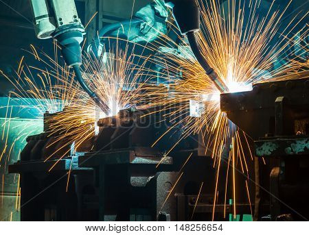 Robots welding  movement in a car production factory