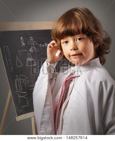 schoolboy thought board, a child in a white coat think about the response from the school board
