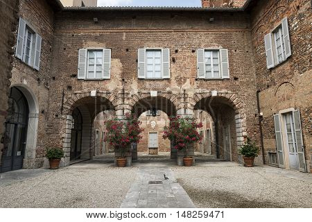 FAGNANO OLONA, ITALY - JUNE 25, 2016: Fagnano Olona (Varese Lombardy Italy): the medieval castle built in the 15th century a court