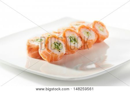 Sushi Roll with Cucumber inside and Salmon outside
