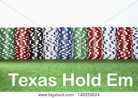 Stacks of Gambling Chips with text saying Texas Hold Em