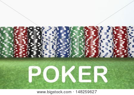 Stacks of Gambling Chips with text saying Poker
