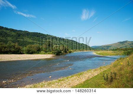 the river flows through mountains Carpathians in Ukraine