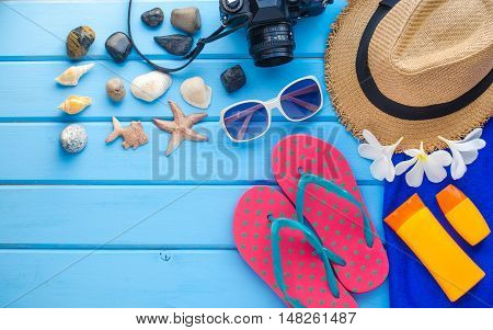 Accessories costume for summer on blue wooden floor