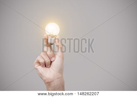 Business hand holding light bulb concept of new ideas with new innovation and new creativity.