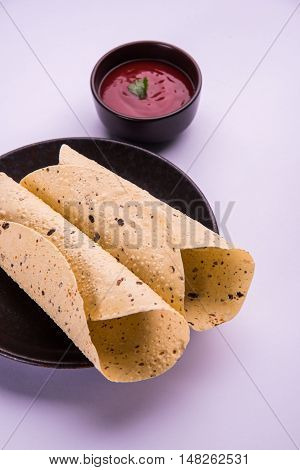 rosted papad or roll papad, indian traditional started food or side dish