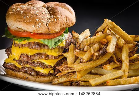 Heart attack on a bun one pound cheeseburger with French fries