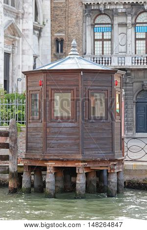 Wooden Kiosk Cabin at Canal in Venice