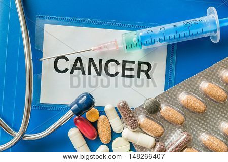 Cancer Desease Concept. A Lot Of Pills Around.