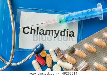 Chlamydia Desease Concept. A Lot Of Pills And Syringe Around.
