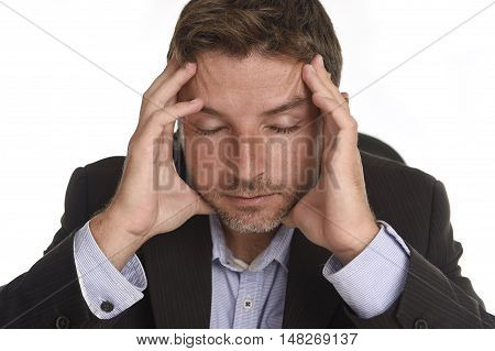 young attractive businessman suffering work stress and headache holding his head tempo with his hands looking tired and worried wearing office suit isolated on white background