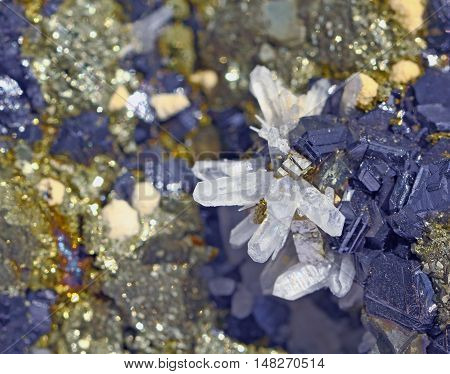 On wards blue galena and limpid white quartz in the background shimmer of the same