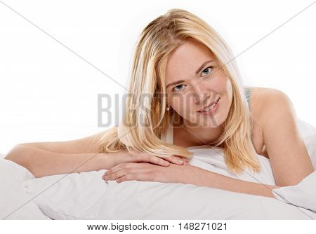 young woman laying in bedroom at early morning, on white background