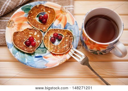 Fritters with cranberry and cup of tea