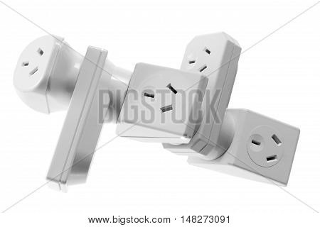 Stack of Power Adaptors on White Background