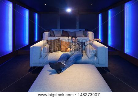 Man in the home theater, luxury interior