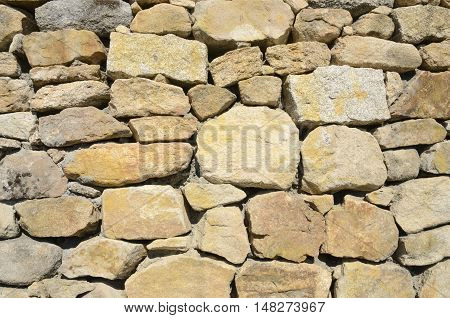 Background of stone wall in Tui Galicia Spain.