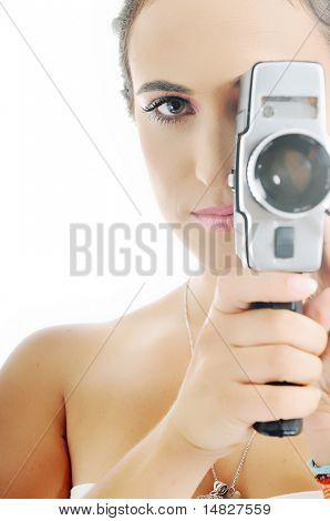 young beautiful woman face closeup with old fashion film camera
