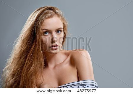 Closeup portrait of sensual woman looking at camera