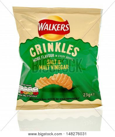 Winneconne WI - 29 July 2016: Bag of Walkers crinkles in salt & malt vinegar flavour on an isolated background.