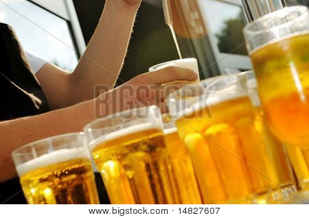 barman beer drink on buffet party background