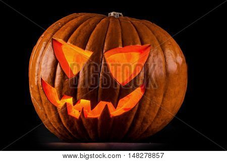 Funny glowing Halloween pumpkin isolated on a black background